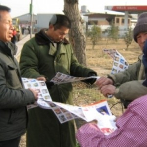 Passing out pamphlets from Heibei to Henan.