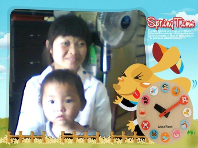 邓露荣和大儿子。